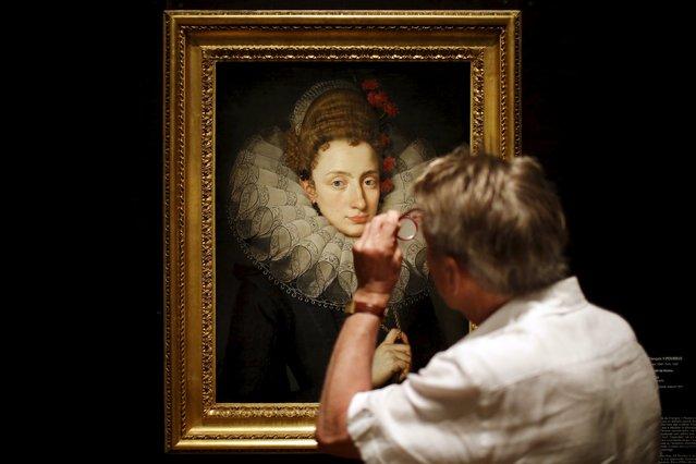 "A man looks at ""Portrait de femme"" of Francois II Pourbus during the media visit of the ""A journey to Nantes"" (Le Voyage a Nantes) art festival in Nantes, France, June 30, 2015. (Photo by Stephane Mahe/Reuters)"