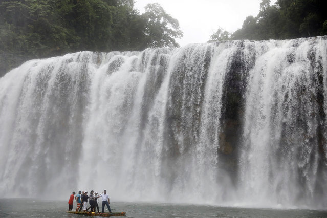 Philippine Environment department staff ride on a raft as they inspect Tinuy-an Waterfalls in Bislig, Surigao del Sur in southern Philippines February 15, 2017. (Photo by Erik De Castro/Reuters)