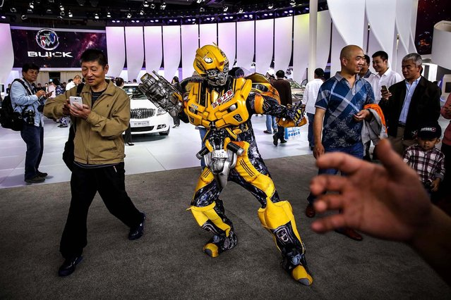 A transformers performer poses for photo during the 2014 Beijing International Automotive Exhibition at China International Exhibition Center  in Beijing, China, on April 21, 2014. More than 2,000 automotive enterprises from 14 countries and regions participated in the show. (Photo by Feng Li/Getty Images)