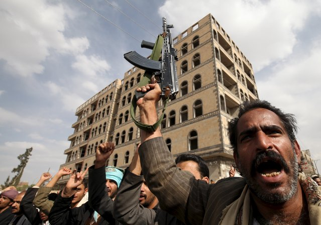 A Houthi follower holds up a rifle as he shouts slogans during a demonstration against the United Nations in Sanaa, Yemen, July 5, 2015. Hundreds of supporters of the Iran-backed Houthi rebels took to the streets of the Yemeni capital on Sunday to protest against the United Nations and its alleged support of Yemen's exiled President Abd-Rabbu Mansour Hadi. (Photo by Mohamed al-Sayaghi/Reuters)