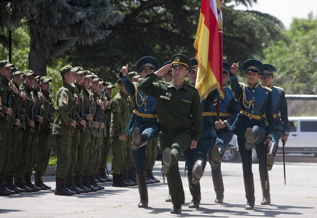 Servicemen of the military forces of South Ossetia march during an oath of allegiance ceremony in Tskhinvali, the capital of the breakaway region of South Ossetia, Georgia, July 5, 2015. (Photo by Kazbek Basaev/Reuters)