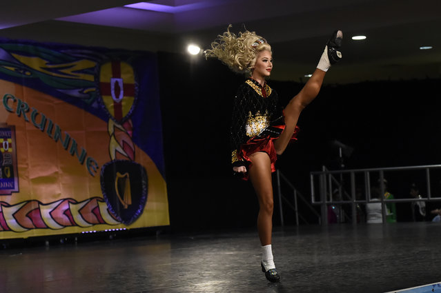 A dancer performs on stage during the World Irish Dancing Championships in Dublin, Ireland on April 11, 2017. (Photo by Clodagh Kilcoyne/Reuters)