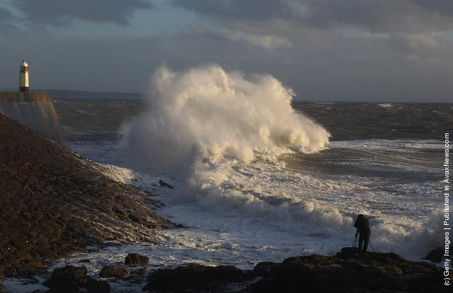 Waves crashing against the harbour wall in Porthcawl, Wales