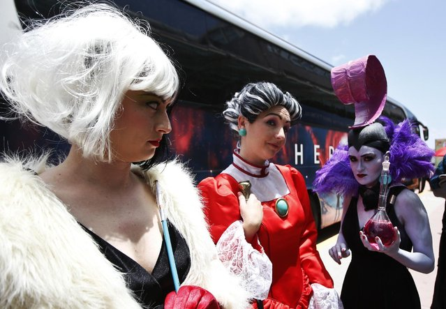 Fans wear costumes at the convention center on opening day of the 2015 Comic-Con International Thursday, July 9, 2015, in San Diego. (Photo by Lenny Ignelzi/AP Photo)