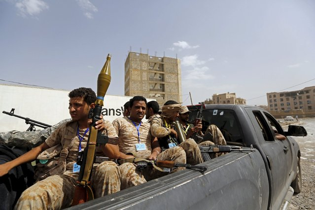 Houthi fighters ride on the back of a patrol truck in Yemen's capital Sanaa July 10, 2015. Yemen's main warring factions endorsed a U.N.-brokered humanitarian truce from midnight on Friday although heavy fighting on the ground and Saudi air strikes carried on relentlessly. (Photo by Khaled Abdullah/Reuters)
