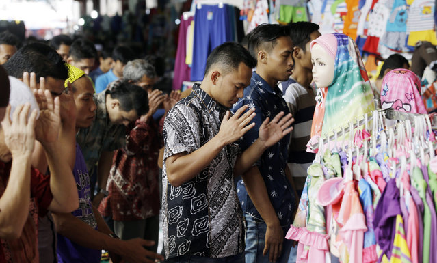 Indonesian Muslims pray during a Friday prayer at a market in Jakarta, Indonesia, Friday, July 10, 2015. (Photo by Achmad Ibrahim/AP Photo)