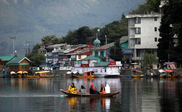 Women row a small boat in the waters of Dal lake, in Srinagar, September 17, 2019. (Photo by Francis Mascarenhas/Reuters)