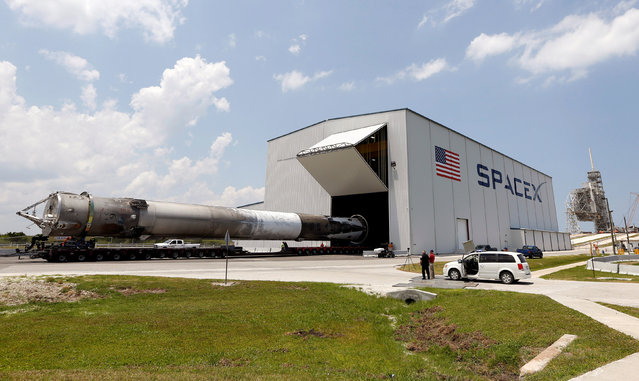 The recovered first stage of a SpaceX Falcon 9 rocket is transported to the SpaceX hangar at historic launch pad 39A at the Kennedy Space Center in Cape Canaveral, Florida May 14, 2016. (Photo by Joe Skipper/Reuters)