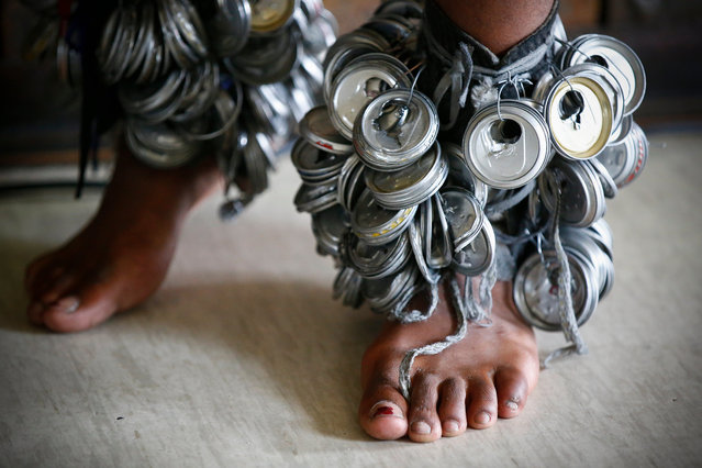 Detail of ankle instruments made from cans worn by a South African Xhosa traditional dancer performing for Public Protector Advocate Busisiwe Mkhwebane during a stakeholder meeting at the Community Hall in Masiphumelele, Cape Town, South Africa, 05 May 2017. South African Public Protector Advocate Busisiwe Mkhwebane is on a countrywide roadshow trying to asses at grassroots level the situation in communities across South Africa. Masiphumelele has an active investigation with the South African Human Rights Commission regarding land issues and Water and Sanitation issues. The stakeholder meeting in Masiphumelele enabled the Public Protector to listen to the community and its problems. Advocate Busisiwe Mkhwebane took the position as CEO of the Public Protectors office in October 2016 succeeding former Law Reform Commissioner and advocate, Thuli Madonsela. The Office of the Public Protector was established to support constitutional democracy in the country and is an external state institution tasked with the investigation of misconduct in any state affairs and all aspects of government including that of public administration and is independent of the government. (Photo by Nic Bothma/EPA)