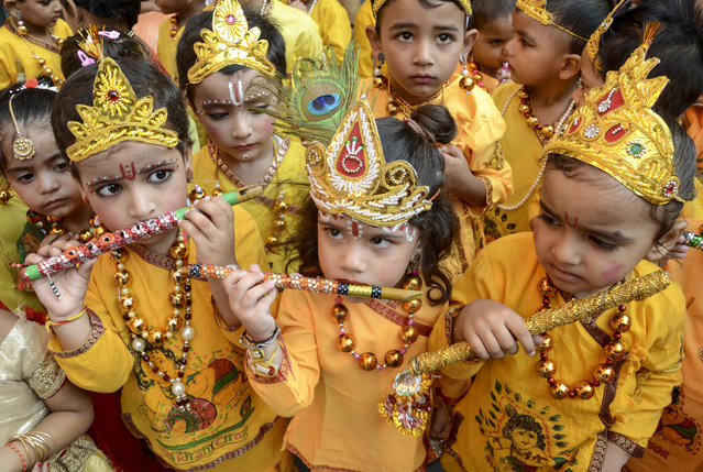 School children dressed up as Hindu deity Krishna perform during celebrations on the eve of the Janmashtami festival that marks Krishna's birthday, in Amritsar on August 23, 2019. (Photo by Narinder Nanu/AFP Photo)