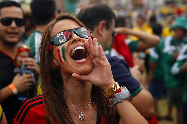 Mexican fans cheer for their team as they arrive for the FIFA World Cup 2014 group A preliminary round match between Brazil and Mexico at the Estadio Castelao in Fortaleza, Brazil, 17 June 2014. (Photo by Kai Foersterling/EPA)