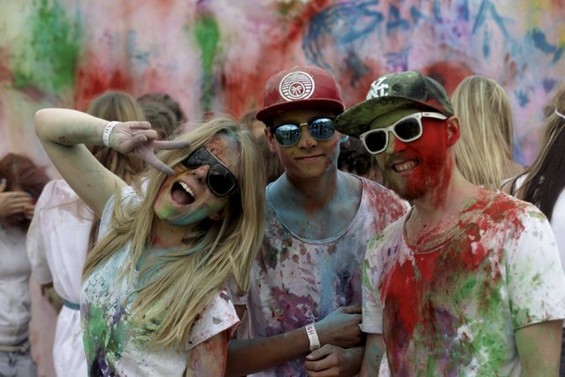 People pose for a picture during the Holi festival, or the Festival of Colors, in Riga, Latvia, August 1, 2015. (Photo by Ints Kalnins/Reuters)