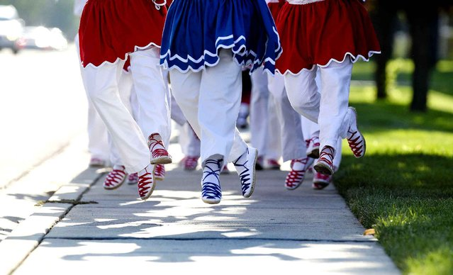 Onati Basque dancers go airborne as they perform Basque traditional dances while making their way to the front of Saint Mark's Catholic Church, Saturday, August 1, 2015, in Boise, Idaho. The annual Mass, conducted in English and Basque, was held at the church for the first time. (Photo by Kyle Green/Idaho Statesman via AP Photo)