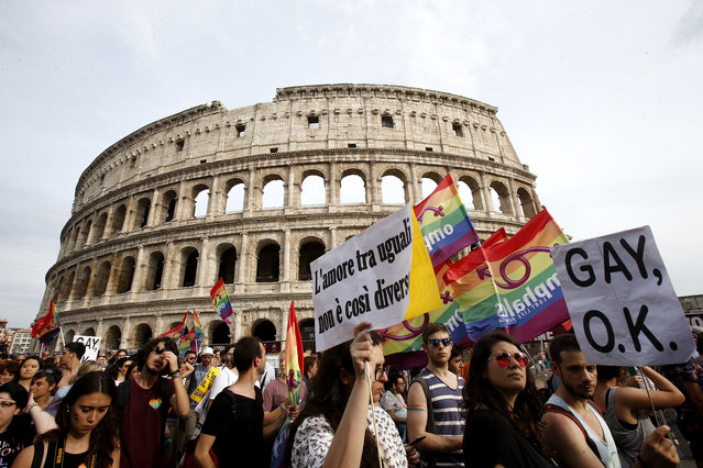 People march past the Colosseum during the Gay Pride parade in Rome, Saturday, June 11, 2016. (Photo by Fabio Frustaci/AP Photo)
