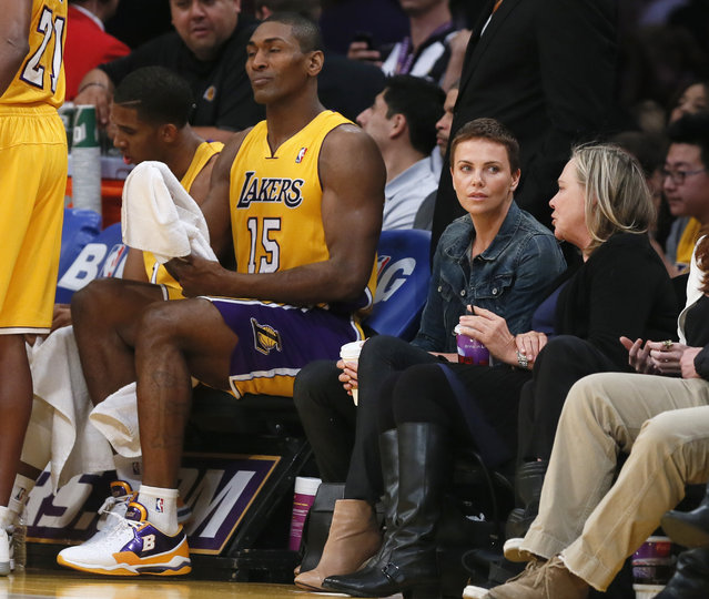 Charlize Theron and her mother Gerda Jacoba Aletta sit next to Metta World Peace as they watch the Thunder play the Lakers in Los Angeles, January 2013. (Photo by Lucy Nicholson/Reuters)
