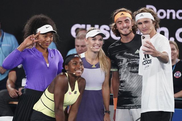 From left, Naomi Osaka of Japan, Coco Gauff of the United States, Caroline Wozniacki of Denmark, Stefanos Tsitsipas of Greece, and Alexander Zverev of Germany pose for a selfie during the Rally For Relief at Rod Laver Arena in Melbourne, Wednesday, January 15, 2020. Tennis stars have come together for the Rally for Relief to raise money in aid of the bushfire relief efforts across Australia. (Photo by Scott Barbour/AAP Image via AP Photo)