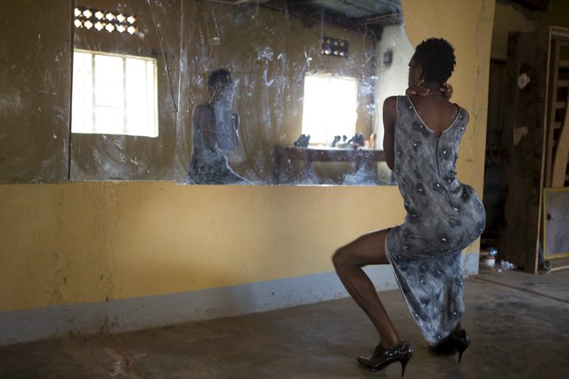 Alicia, a participant of the Mr and Miss Pride beauty contest, dances during rehearsals at an undisclosed venue in Kampala, Uganda August 1, 2015. (Photo by Edward Echwalu/Reuters)