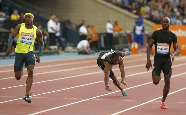 Yohan Blake of Jamaica falls injured in the men's 100m during the IAAF Diamond League athletics meeting at Hampden Park in Glasgow July 11, 2014. (Photo by Phil Noble/Reuters)