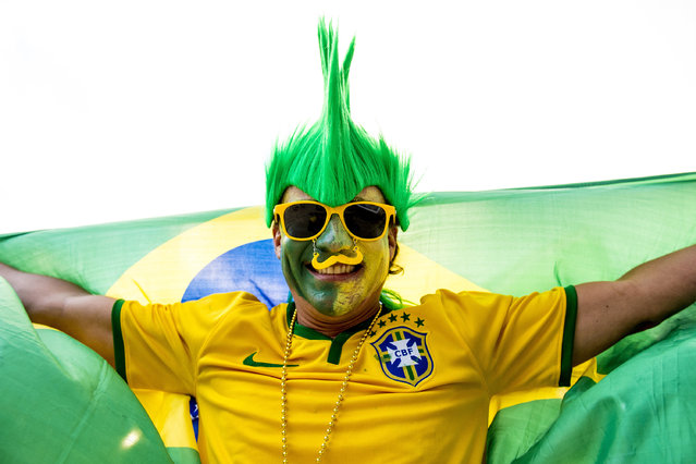 A fan of Brazil cheer their team during a group B match between Brazil and Peru at Gillette Stadium as part of Copa America Centenario US 2016 on June 12, 2016 in Foxboro, Massachusetts, US. (Photo by Billie Weiss/LatinContent/Getty Images)