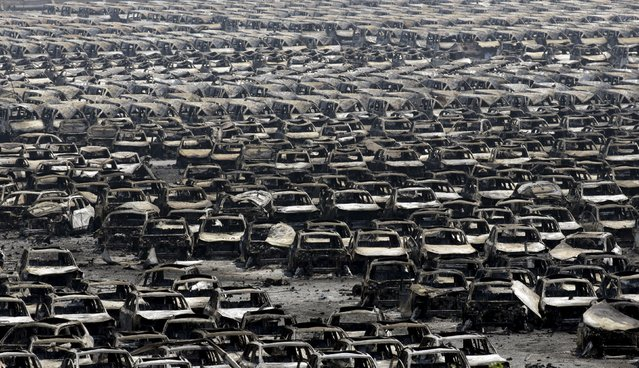 Damaged cars are seen near the site of the explosions at the Binhai new district, Tianjin, August 13, 2015. (Photo by Jason Lee/Reuters)