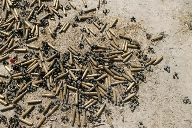 Bullet casings from clashes are seen on the ground in Falluja, Iraq, June 26, 2016. (Photo by Thaier Al-Sudani/Reuters)