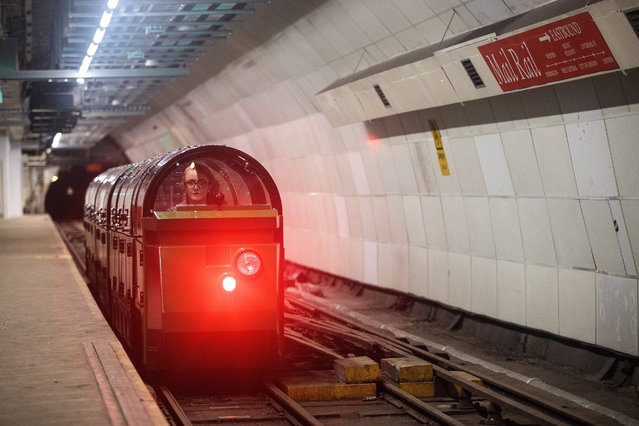 Mail Rail train driver Penelope Veck drives through the underground eastbound Mount Pleasant Sorting Office station on July 28, 2017 in London, England. The Postal Museum opens to the public today and features artefacts from 500 years of postal history. Mail Rail, which opens September 4, 2017, is a 1km long section of the underground railway network which was built to transport letters and parcels between 1927 and 2003. (Photo by Jack Taylor/Getty Images)