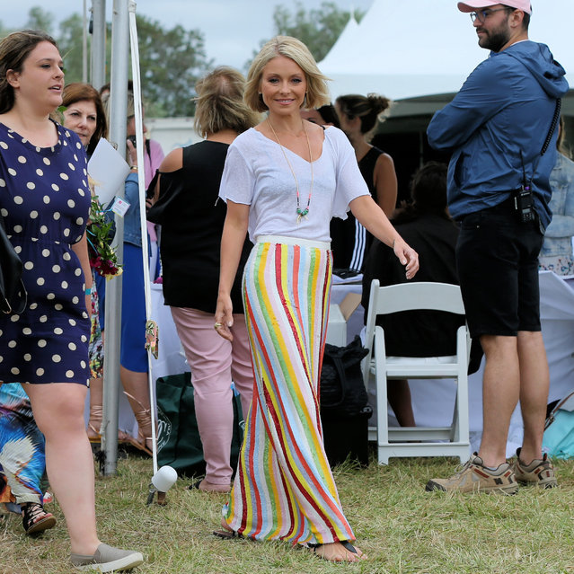 TV personality Kelly Ripa, wearing a J. Crew striped skirt and t-shirt, attends OCRFA's 20th Annual Super Saturday to Benefit Ovarian Cancer at Ark Project in Bridgehampton, New York on July 30, 2017. (Photo by Christopher Peterson/Splash News and Pictures)