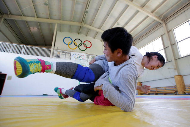 Mongolia's Oyuntuya OtgoNbat (R) fights with her training partner during a daily training session at the Mongolia Women's National Wrestling Team training centre in Bayanzurkh district of Ulaanbaatar, Mongolia, July 1, 2016. (Photo by Jason Lee/Reuters)