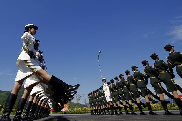 Soldiers of China's People's Liberation Army march with their weapons during a training session for a military parade to mark the 70th anniversary of the end of the World War Two, at a military base in Beijing, China, August 22, 2015. (Photo by Damir Sagolj/Reuters)
