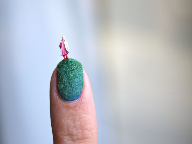 Index-linked: A tiny figure stands at the end of Alice's nail. (Photo by Alice Bartlett/Flickr)