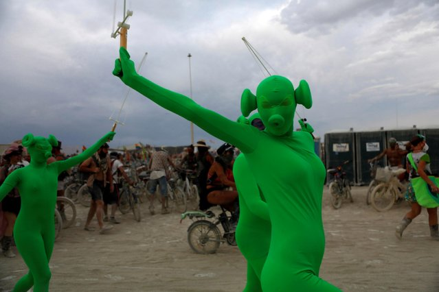 A participant dances as approximately 70,000 people from all over the world gathered for the annual Burning Man arts and music festival in the Black Rock Desert of Nevada, U.S. August 29, 2017. (Photo by Jim Urquhart/Reuters)