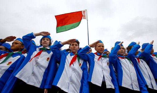 Belarusian schoolchildren salute during celebrations commemorating the 27th anniversary of the country's Young Pioneer movement in Minsk, Belarus September 13, 2017. Early pro-communist pioneer movements appeared in Russia after the 1917 Bolshevik revolution and in May 1922, they were organised into the Young Pioneer Organisation of the Soviet Union with units active in all republics of the union. In Belarus, the Young Pioneers remains a government-loyal youth movement. (Photo by Vasily Fedosenko/Reuters)