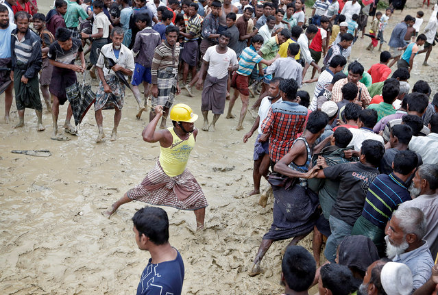 Rohingya refugees react as aid is distributed in a camp in Cox's Bazar, Bangladesh, September 19, 2017. (Photo by Cathal McNaughton/Reuters)