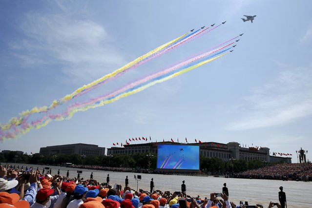 Military aircraft perform during the military parade marking the 70th anniversary of the end of World War Two, in Beijing, China, September 3, 2015. (Photo by Damir Sagolj/Reuters)