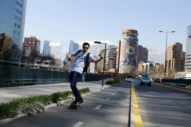 A man skateboards along a street in a business district in Santiago, Chile, September 3, 2015. (Photo by Ivan Alvarado/Reuters)