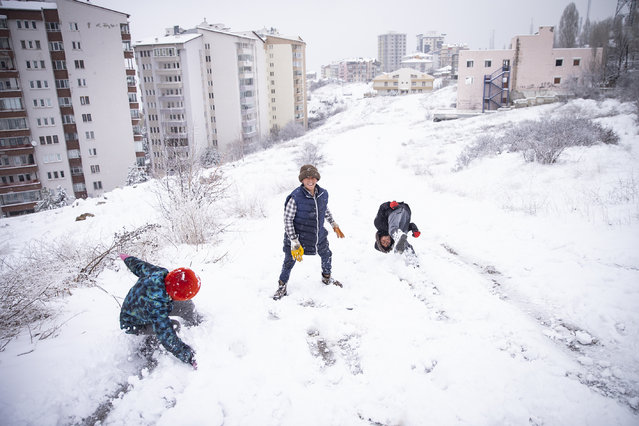 Children enjoy the snow following a snowfall in Keklikpinari district of Turkish Capital Ankara on March 19, 2020. (Photo by Ozge Elif Kizil/Anadolu Agency via Getty Images)