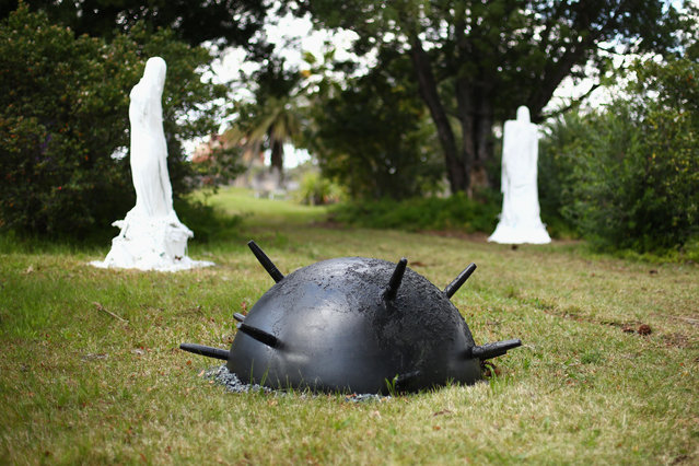 """Two Figures and a Sea Mine"" by Stephen Harrison is seen as part of the ""Hidden"" annual sculpture exhibition at Rookwood Cemetery on September 15, 2014 in Sydney, Australia. (Photo by Mark Kolbe/Getty Images)"
