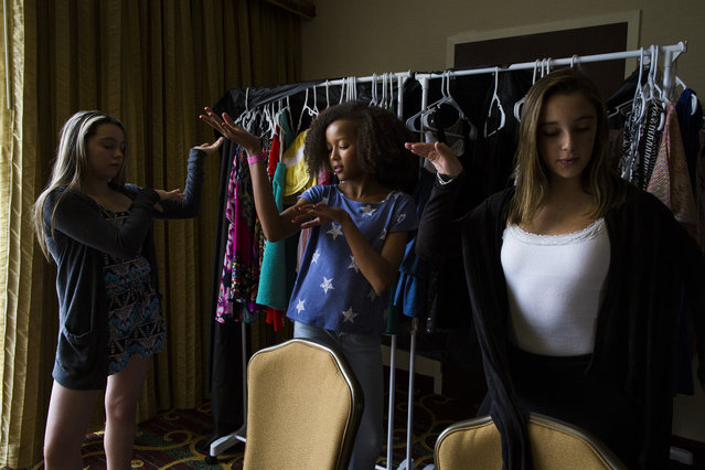 Aicha Bleers, 11, of Chevy Chase, Md., practices her runway posing at a modeling camp at the Courtyard Marriott Hotel in McLean, Va., on Tuesday, August 18th, 2015. (Photo by Brittany Greeson/The Washington Post)