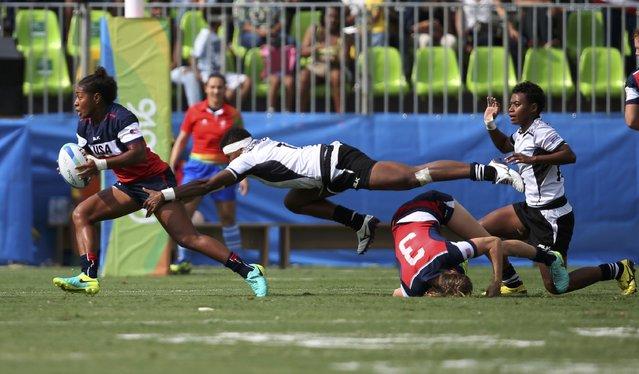 2016 Rio Olympics, Rugby, Women's Placing 5-8 Fiji vs USA, Deodoro Stadium, Rio de Janeiro, Brazil on August 8, 2016. Akalaini Baravilala (USA) of USA is tackled by Rusila Nagasau (FIJ) of Fiji. (Photo by Alessandro Bianchi/Reuters)