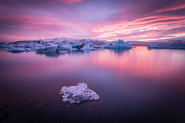 """Dreamscape"". A stunning sunset painted the sky over the Jokulsarlon Glacer Lagoon in South Iceland. It was a typical cloudy day in the Icelandic summer. The day was not hoping for a nice sunset, but I still decided to go on the spot, hoping to finally see the sun once the same had left behind the clouds. (Photo and caption by Francesco Riccardo Iacomino/National Geographic Photo Contest)"