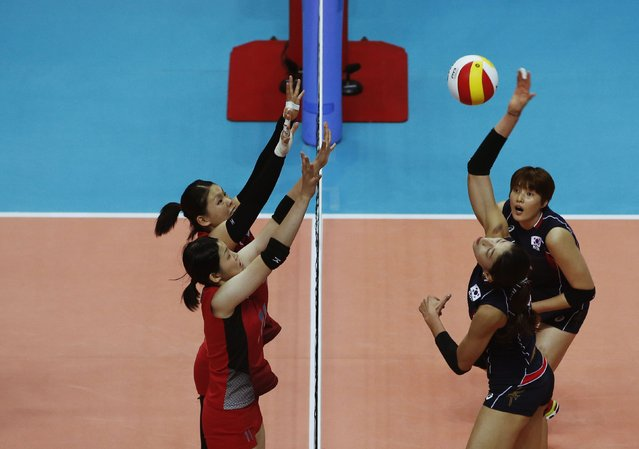 South Korea's Kim Yeon-koung spikes against Japan during their women's volleyball semi-final match at the Ansan Sangroksu Gymnasium during the 17th Asian Games in Incheon September 30, 2014. (Photo by Kim Hong-Ji/Reuters)