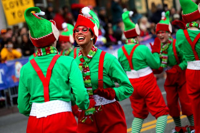 Santa's Elves perform during the American Thanksgiving Parade in downtown Detroi. (Photo by Kimberly P. Mitchell/Detroit Free Press)