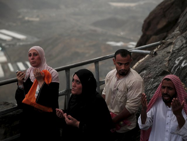 Muslim pilgrims pray as they visit Hera cave, where Muslims believe Prophet Mohammad received the first words of the Koran through Gabriel, at the top of Mount Al-Noor during the annual haj pilgrimage in the holy city of Mecca, September 21, 2015. (Photo by Ahmad Masood/Reuters)