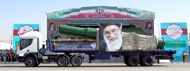 A military truck carrying a missile and a picture of Iran's Supreme Leader Ayatollah Ali Khamenei is seen during a parade marking the anniversary of the Iran-Iraq war (1980-88), in Tehran September 22, 2015. (Photo by Raheb Homavandi/Reuters/TIMA)