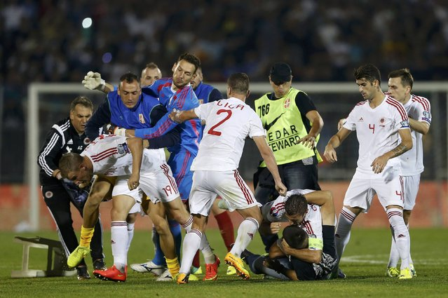 Fans and players of Serbia and Albania clash during their Euro 2016 Group I qualifying soccer match at the FK Partizan stadium in Belgrade October 14, 2014. (Photo by Marko Djurica/Reuters)