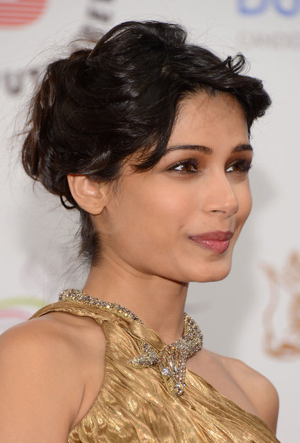 """Actress Freida Pinto attends the """"Life of PI"""" Opening Gala during day one of the 9th Annual Dubai International Film Festival held at the Madinat Jumeriah Complex on December 9, 2012 in Dubai, United Arab Emirates. (Photo by Andrew H. Walker/Getty Images for DIFF)"""