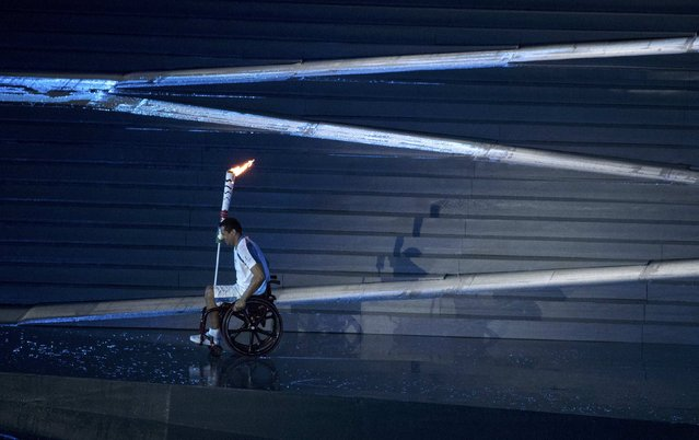 2016 Rio Paralympics, Opening ceremony, Maracana, Rio de Janeiro, Brazil on September 7, 2016. Brazilian Paralympic swimmer Clodoaldo Silva carries the torch during the opening ceremony. (Photo by Ricardo Moraes/Reuters)