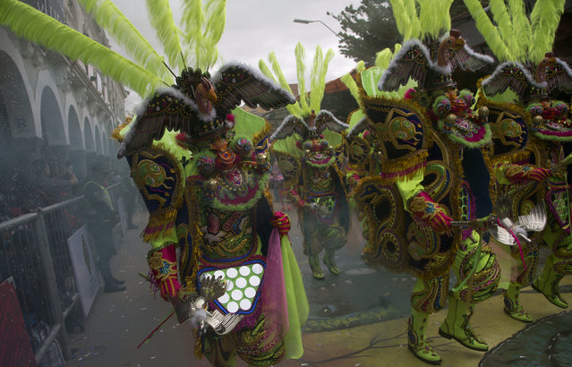 "Traditional ""Morenada"" dancers perform during the Carnival in Oruro, Bolivia, Saturday, February 10, 2018. (Photo by Juan Karita/AP Photo)"