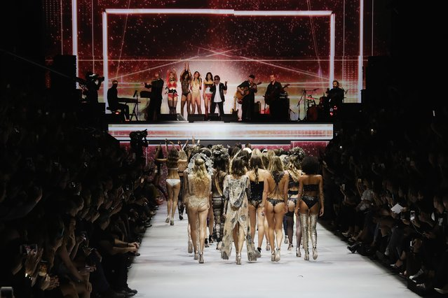 Models walks the runway during the Etam show as part of the Paris Fashion Week Womenswear Spring/Summer 2017 on September 27, 2016 in Paris, France. (Photo by Vittorio Zunino Celotto/Getty Images)