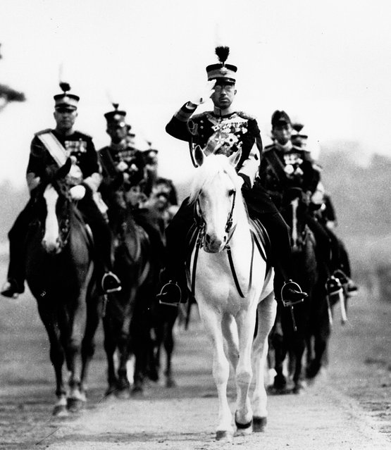 In this 1937 file photo, Japan's Emperor Hirohito salutes from his mount, his favorite white horse, during a military review in Tokyo. The original recording of Japan's Emperor Hirohito's war-ending speech has come back to life in digital form. The original sound was released Saturday, Aug. 1, 2015 by the Imperial Household Agency in digital format, ahead of the 70th anniversary of the speech and the war's end. (Photo by AP Photo)
